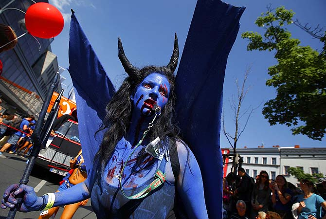 A reveller participates in the Karneval der Kulturen (Carnival of Cultures), a street parade of Berlin's ethnic minorities, in Berlin.—Photo by Reuters