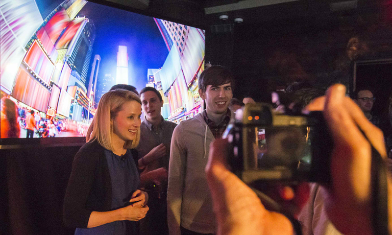 Yahoo Chief Executive Marissa Mayer and Tumblr founder and CEO David Karp are seen being photographed after a news conference in New York May 20, 2013. — Reuters Photo