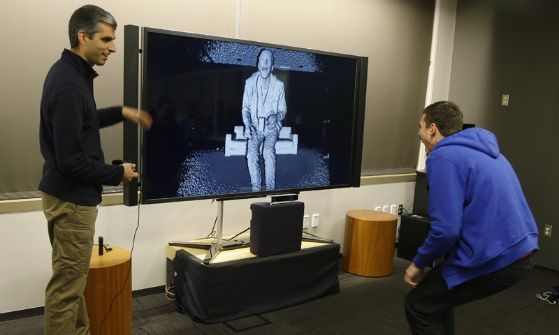 Kareem Choudhry, left, demonstrates the level of detail in the camera of the new Kinect for the next-generation Xbox One. — AP Photo