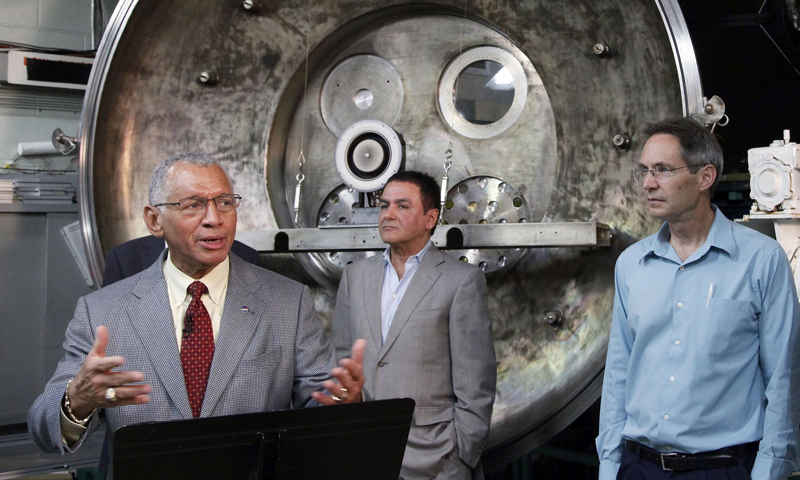 NASA Administrator Charles Bolden, left to right, Firouz Naderi, Director for the Solar System Exploration, and John Brophy, Electric Propulsion Engineer, are shown during Bolden's visit to the Jet Propulsion Laboratory in Pasadena, Calif., on Thursday, May 23, 2013. NASA engineers are developing an ion engine for an asteroid capture mission later this decade. — AP Photo