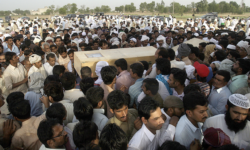 People attend the funeral of victims of a gas cylinder explosion on a minibus, in Gujrat, Pakistan. — AP Photo