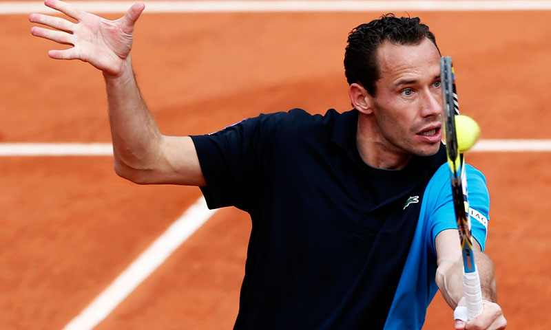 France's Michael Llodra returns the ball to Belgium's Steve Darcis during their first round match. —AP Photo
