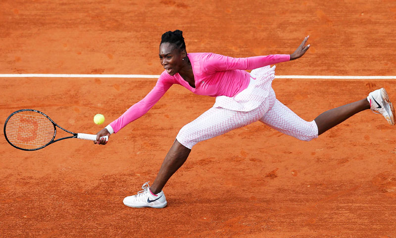 Venus Williams of the US hits a return to Urszula Radwanska of Poland during their women's singles match. Radwanska defeated Williams 7-6(5) 6-7(4) 6-4. —Reuters Photo