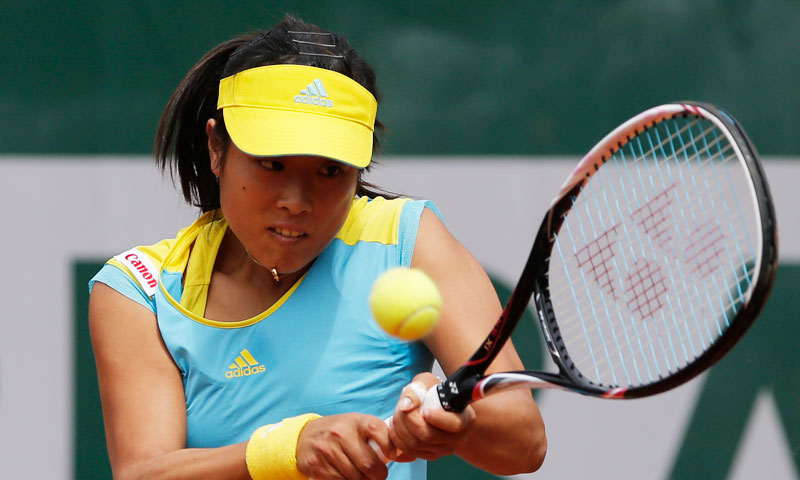 Japan's Ayumi Morita returns the ball to Kazakhstan's Yulia Putintseva during their first round match. —AP Photo