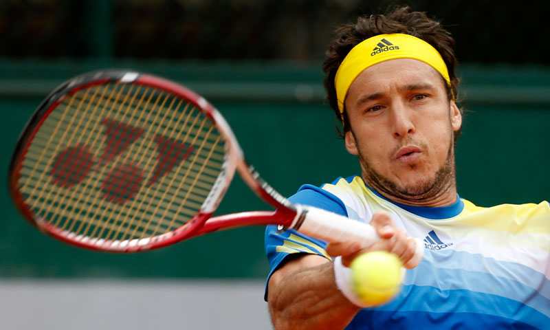 Argentina's Juan Monaco returns the ball to Spain's Daniel Gimeno Traver during their first round match. —AP Photo