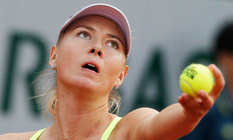 Russia's Maria Sharapova serves against Su-Wei Hsieh of Taipei in their first round match. —AP Photo