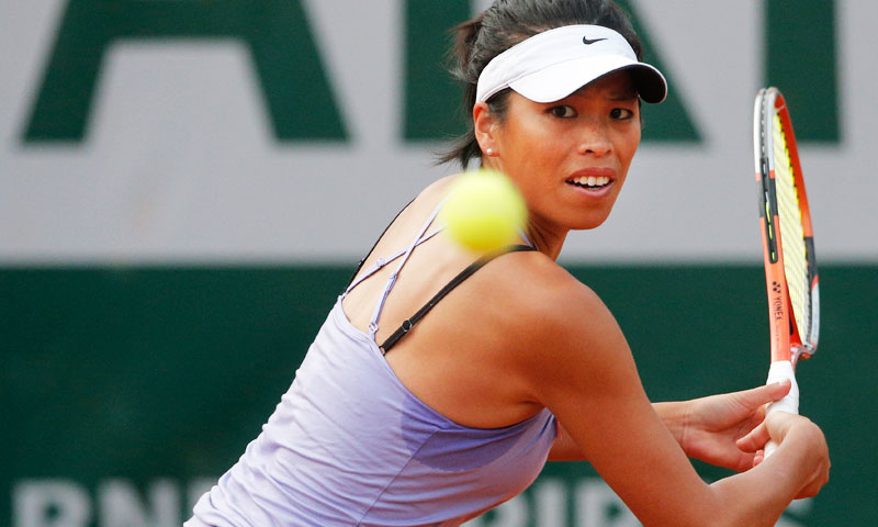 Su-Wei Hsieh, of Taipei, returns against Russia's Maria Sharapova in their first round match of the French Open tennis tournament on day two. —AP Photo