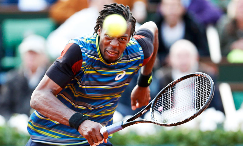 Gael Monfils of France eyes the ball during his men's singles match against Tomas Berdych of Czech Republic. —Reuters Photo