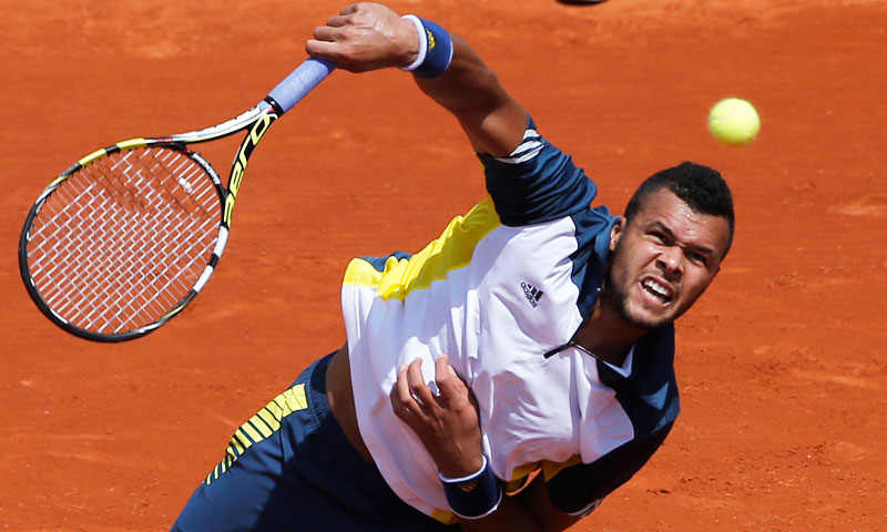 France's Jo-Wilfried Tsonga serves the ball to Slovenia's Aljaz Bedene during their first round match. Tsonga won 6-2, 6-2, 6-3. —AP Photo
