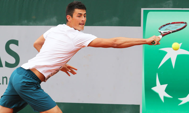 Australia's Bernard Tomic returns against Romania's Victor Hanescu. —AP Photo