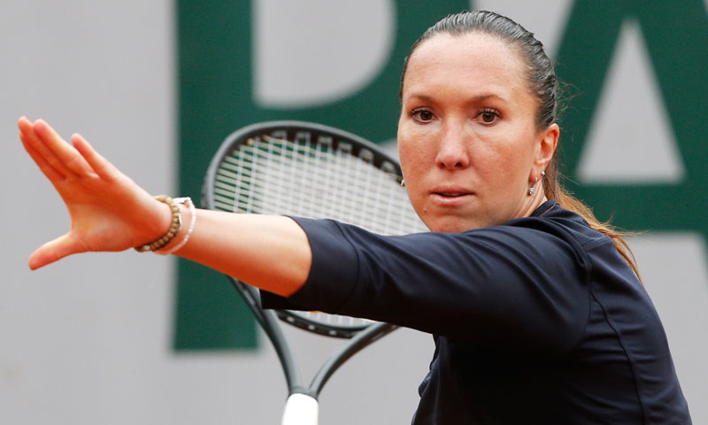 Serbia's Jelena Jankovic returns the ball to Slovakia's Daniela Hantuchova. —AP Photo
