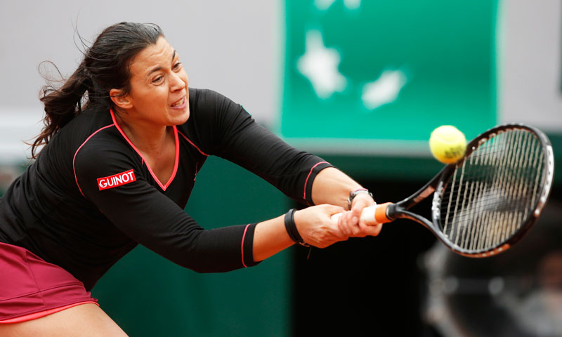 France's Marion Bartoli returns the ball to Olga Govortsova, of Belarus, during their first round match. —AP Photo