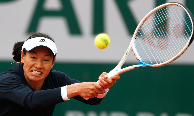 Japan's Kimiko Date-Krumm returns the ball to Australia's Samantha Stosur. —AP Photo