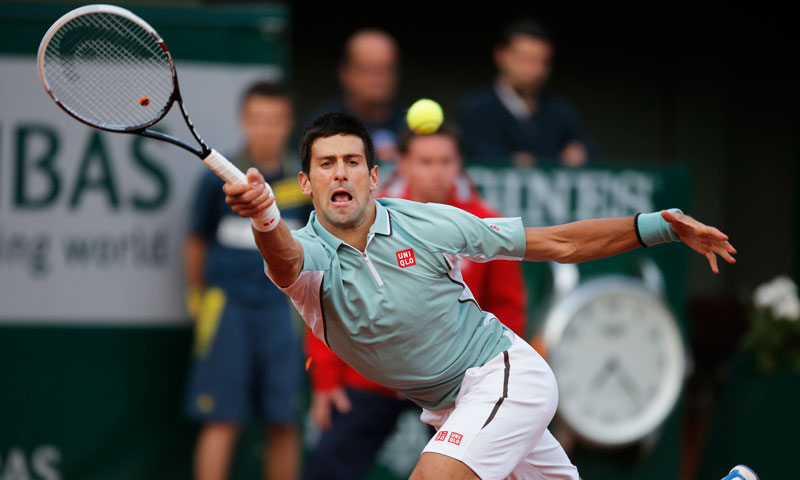 Serbia's Novak Djokovic returns against David Goffin of Belgium during their first round match at the French Open tennis tournament. He defeated Goffin with 7-6 (5), 6-4, 7-5. —AP Photo