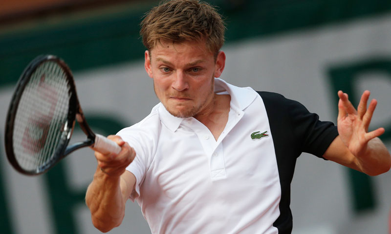 David Goffin of Belgium returns against Serbia's Novak Djokovic during their first round match. —AP Photo
