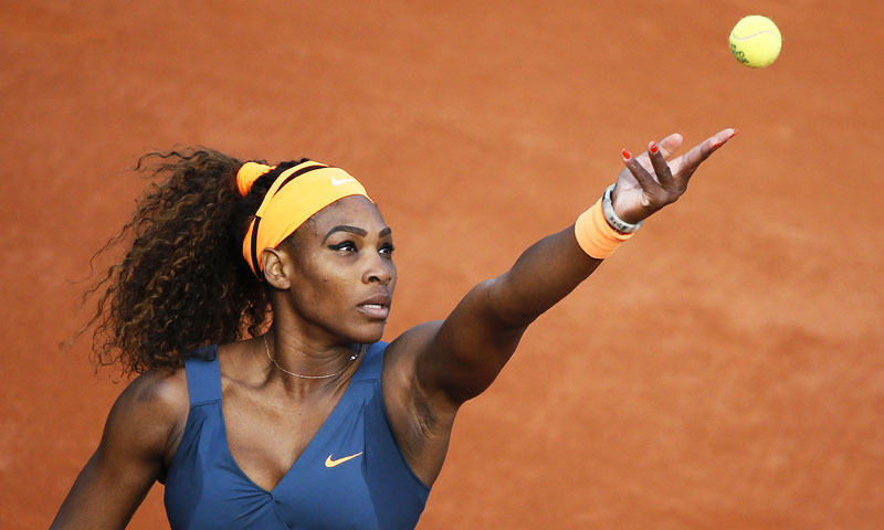 USA's Serena Williams serves to France's Caroline Garcia. Williams won in two sets 6-1, 6-2.  —AFP Photo