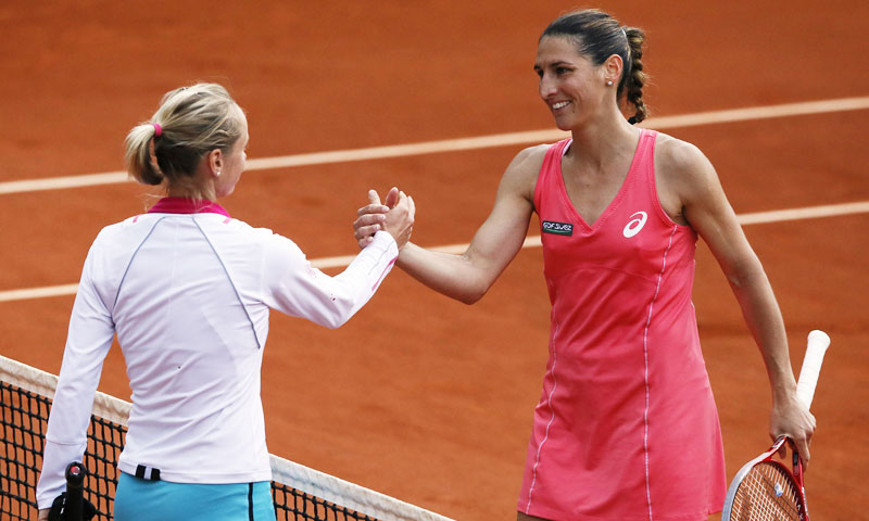 France's Virginie Razzano (R) shakes hands with Slovakia's Zuzana Kucova after she won the match.  —AFP Photo