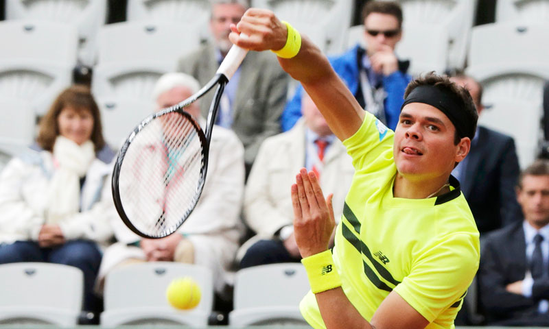 Milos Raonic of Canada serves to Michael Llodra of France during their men's singles match. —Reuters Photo