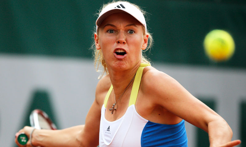 Denmark's Caroline Wozniacki returns the ball to Serbia's Bojana Jovanovski. —AP Photo