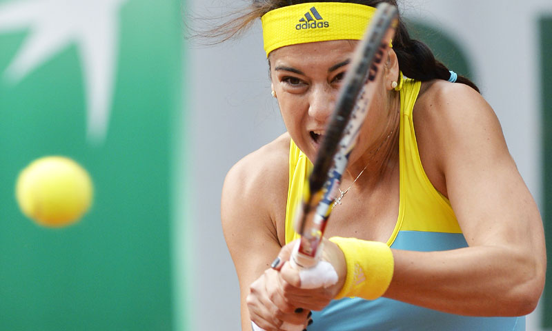 Romania's Sorana Cirstea hits a shot to Sweden's Johanna Larsson. —AFP Photo