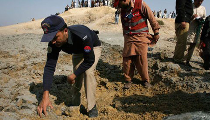 Policeman looks for evidence at the site of a landmine blast. – File Photo