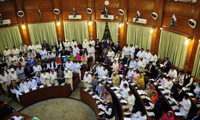 Newly-elected Sindh provincial assembly members take oath an at the main hall of the Sindh provincial assembly building in Karachi on May 29, 2013. — Photo by AFP
