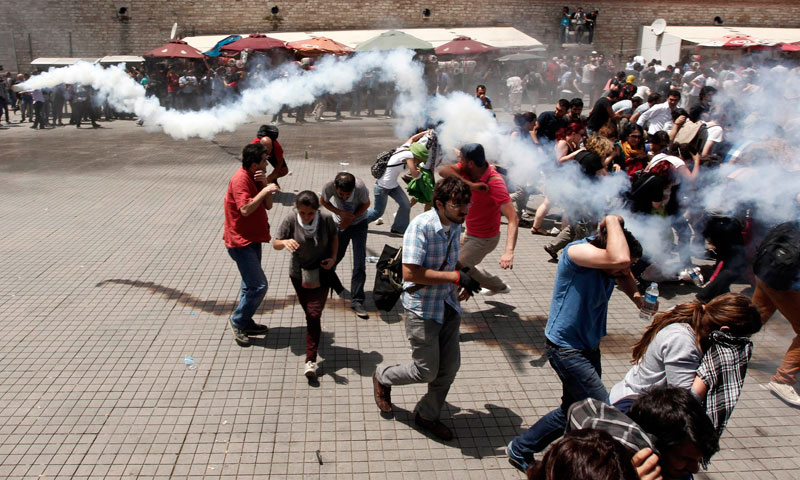 Riot police use tear gas to disperse the crowd during an anti-government protest at Taksim Square in central Istanbul, June 1, 2013. — Photo by Reuters