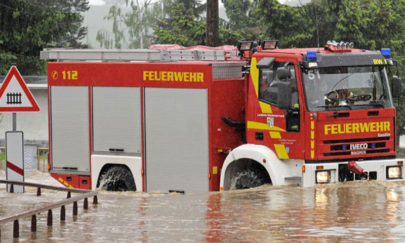 A fire-engine drives through a flooded area near Saara, central Germany. The village is enclosed by the floods. Heavy rainfalls caused flooding along rivers and lakes in Germany, Austria, Switzerland and the Czech Republic.—Photo by AP