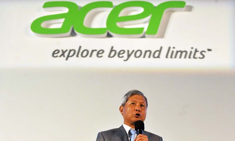 Acer Inc. Chairman and CEO J.T. Wang talks during a press conference ahead of the opening of the Computex trade fair in Taipei on June 3, 2013. — AFP Photo