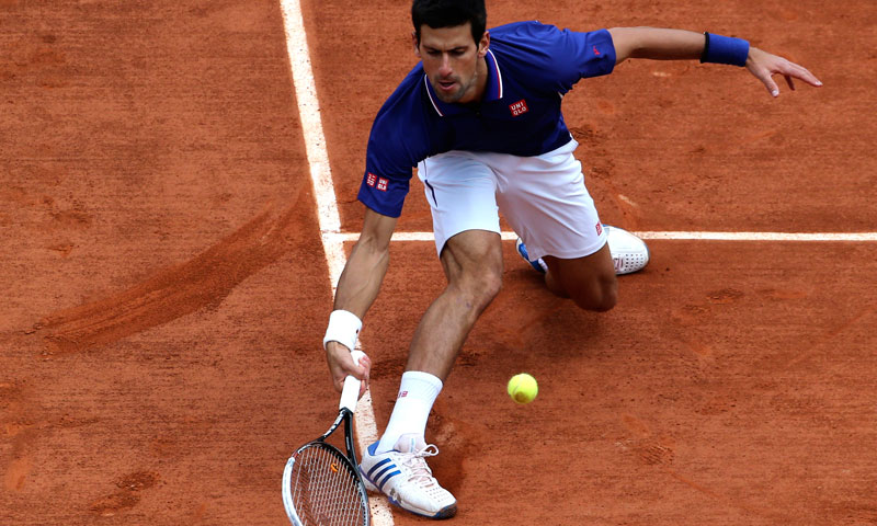 Serbia's Novak Djokovic returns the ball to Germany's Philipp Kohlschreiber during their fourth round match of the French Open tennis tournament at the Roland Garros stadium Monday, June 3, 2013 in Paris. — AP Photo