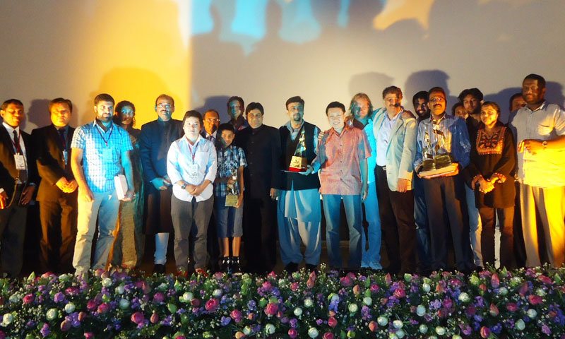 Group photo of award winners with the Chief Guest.