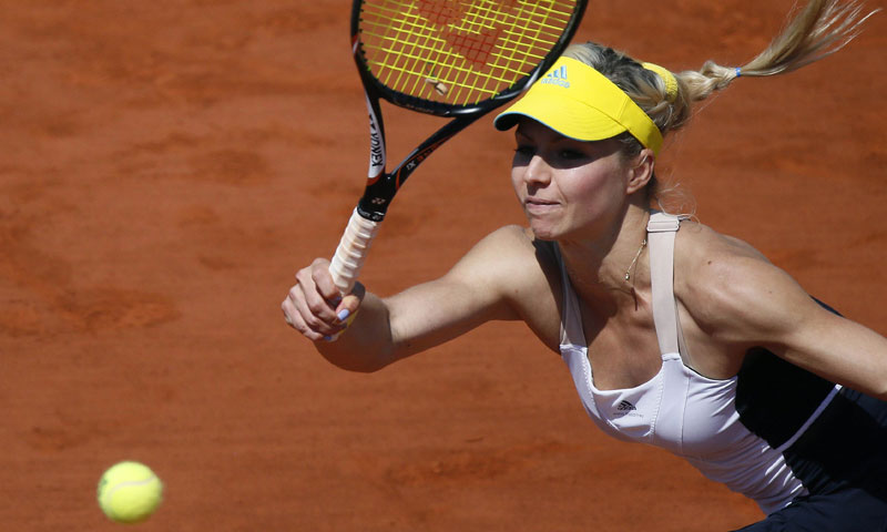 Russia's Maria Kirilenko returns a shot to Belarus' Victoria Azarenka. — AFP Photo