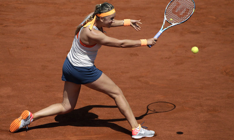 Belarus' Victoria Azarenka returns a shot to Russia's Maria Kirilenko during a French tennis Open quarter final match at the Roland Garros stadium in Paris on June 5, 2013. — AFP Photo