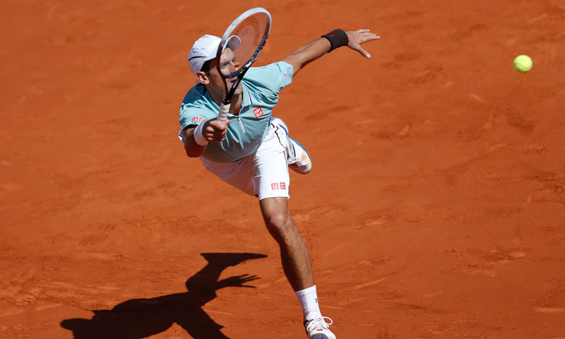 Djokovic hits a forehand on the run. — AP Photo