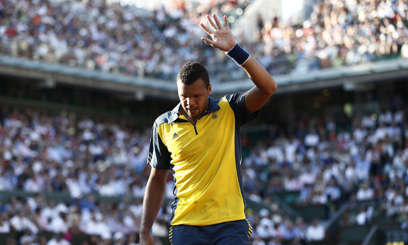 Tsonga reacts. — AFP Photo