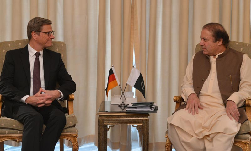 Prime Minister Nawaz Sharif (R) listens to German Foreign Minister Guido Westerwelle during a meeting at the Prime Minister House in Islamabad. -AFP Photo