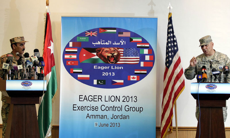 """Operations Chief-of-Staff of the Jordanian armed forces Awni al-Adwan listens on as US Major General Robert G. Catalanotti speaks during a press conference announcing details about """"Exercise Eager Lion"""" on June 9, 2013, in Amman. – AFP Photo"""
