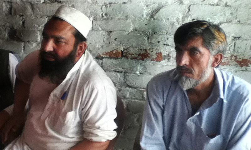 -Raheemullah Khan (R), who was employed at Golf Silk Mill before it was destroyed in a militant attack. — Photos by Author
