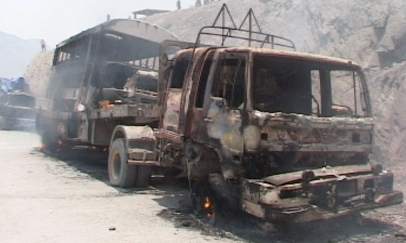 Photo from June 10, 2013 shows a burnt truck carrying Nato supply containers.—Photo by Zahir Shah Sherazi