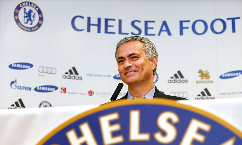 Newly reappointed Chelsea manager Jose Mourinho speaks during a news conference at Stamford Bridge. -Photo by Reuters