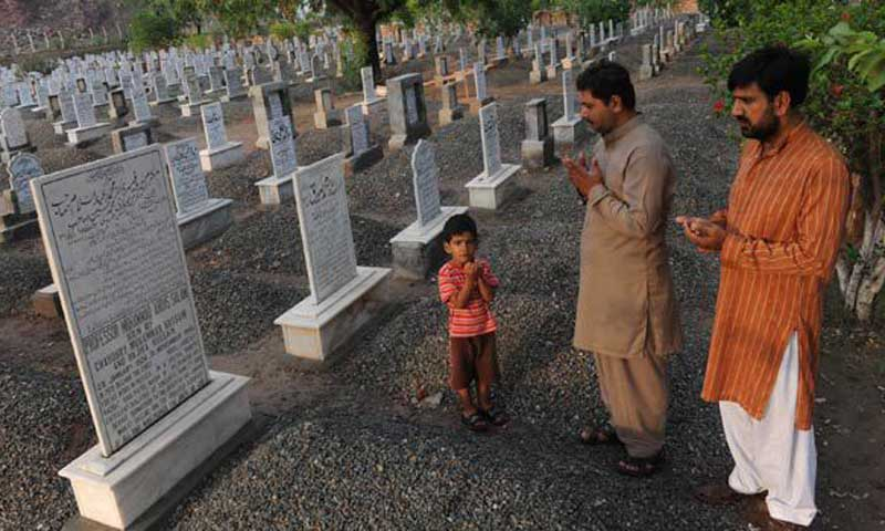 People offer prayers at the grave of Pakistan's only Nobel laureate Professor Abdus Salam, who was a member of the Ahmadiyya community. — AFP/File photo.