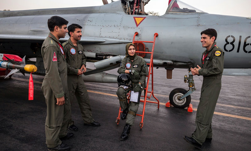 Ayesha Farooq, 26, Pakistan's only female war-ready fighter pilot, chats with her colleagues beside a Chinese-made F-7PG fighter jet at Mushaf base in Sargodha, Pakistan.—Photo by Reuters