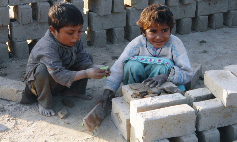 Poverty forces kiln labourers' parents to include their children in the work.— Photo by author.
