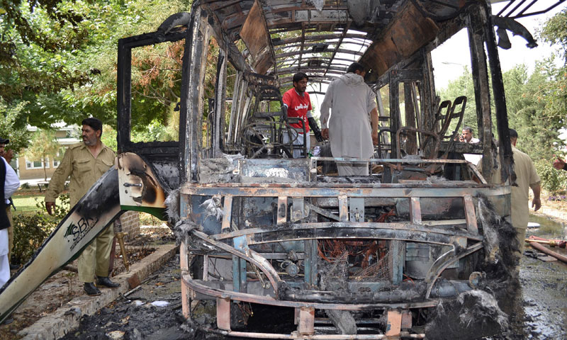 Photo shows the extent of the damage to a bus attacked with improvised explosives. 14 women were killed in the blast at the campus of the Women University Quetta.—AP Photo