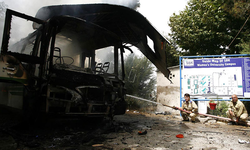 People extinguishing fire off the blast after a blast at Sardar Bahadur Khan Women University.—Online Photo