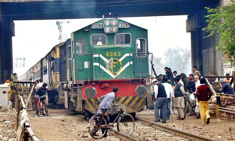 A cyclist crossing railway tracks in a dangerous way at Jhal Khanuwana Phattak. — Photo by APP