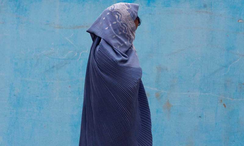 An Afghan woman walks along a street in Herat. — Photo by Reuters/File