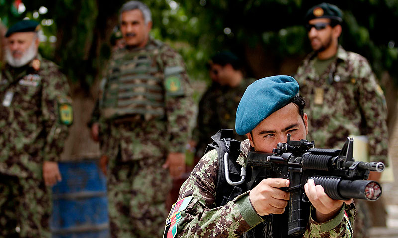 In this Thursday, June 13, 2013 photo, an Afghan National Army soldier aims his weapon, in Sangin district of Kandahar province southern Afghanistan. —AP Photo