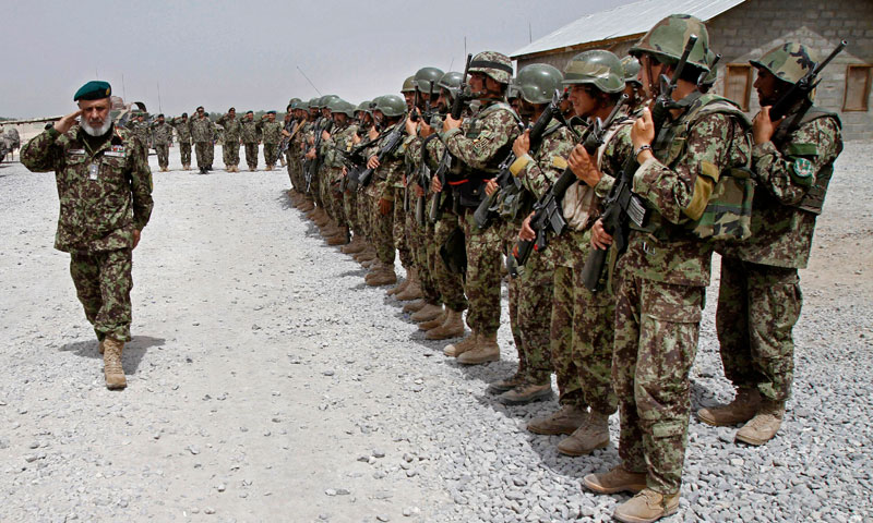 In this Thursday, June 13, 2013 file photo, Afghan National Army soldiers stand in position, in the Sangin district of Kandahar province southern Afghanistan. —AP Photo