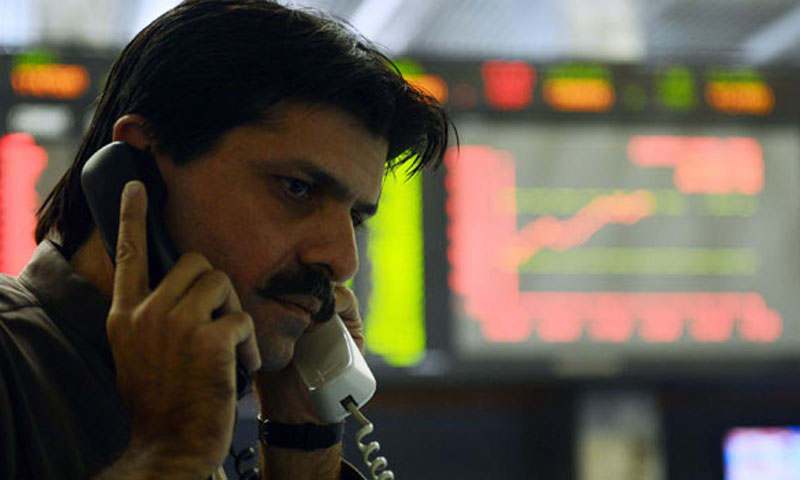 A stockbroker at the Karachi Stock Exchange.—AFP/File Photo